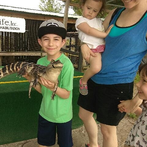 rafi holds gator